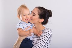 Beautiful young mom with baby stock photo