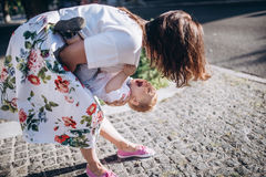Beautiful young mom and cheerful adorable blond boy are playing, having fun. Woman love her son. Royalty Free Stock Images