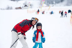 Beautiful young mom and her toddler boy, skiing in the mountains Stock Photo