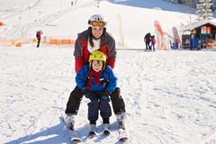 Beautiful young mom and her toddler boy, skiing in the mountains Royalty Free Stock Photography