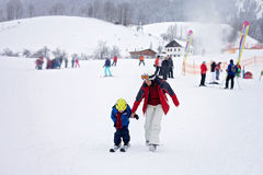 Beautiful young mom and her toddler boy, skiing in the mountains Royalty Free Stock Images