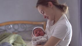 Young mom with newborn baby stock video