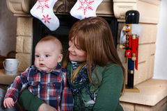 Beautiful young mother and adorable baby boy with Christmas deco Stock Photo