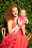 Beautiful young mother with baby stock photography