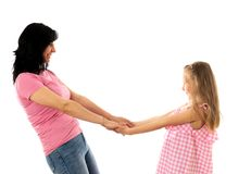 Beautiful young mother and cute charming daughter hugging and playing together. Happy loving family royalty free stock photo