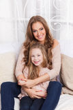 Beautiful young mother and daughter Royalty Free Stock Photos