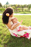 Beautiful young mother with daughter relaxing Stock Photo