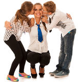 Beautiful young mother with  daughter and son isolated over whit Royalty Free Stock Image