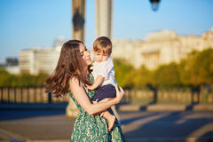Beautiful young mother with her adorable in Paris, France Royalty Free Stock Image