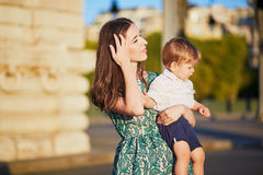 Beautiful young mother with her adorable in Paris, France Royalty Free Stock Photo