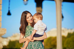 Beautiful young mother with her adorable in Paris, France Royalty Free Stock Images