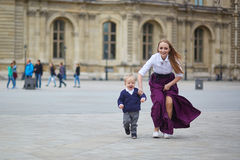 Beautiful young mother and her adorable toddler son in Paris Stock Photos