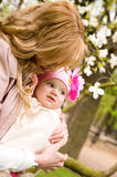 Beautiful young mother with her baby daughter. Outdoors at springtime stock images