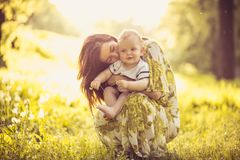 Beautiful young mother with her baby Son at nature. Portrait. royalty free stock photo