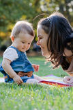 Beautiful young mother and her cute baby. Beautiful young mother and her cute baby in the park Stock Photo