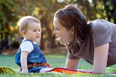 Beautiful young mother and her cute baby. Royalty Free Stock Photography