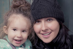Beautiful young mother and her cute daughter smiling Stock Photo