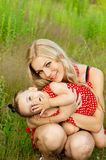 Beautiful young mother with her daughter on a background of natu Royalty Free Stock Image