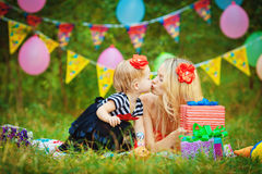 Beautiful young mother and her daughter in the park Stock Photo