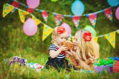 Beautiful young mother and her daughter in the park Royalty Free Stock Image