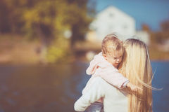Beautiful young mother and her daughter in the park Stock Photos