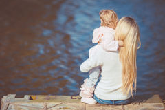 Beautiful young mother and her daughter in the park Royalty Free Stock Photography