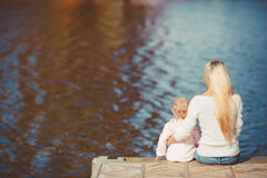 Beautiful young mother and her daughter in the park Stock Photography