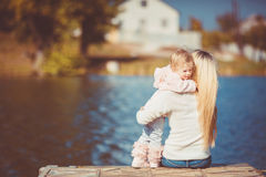 Beautiful young mother and her daughter in the park Royalty Free Stock Photo