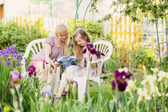 Beautiful young mother and her daughter reading bo Royalty Free Stock Photo