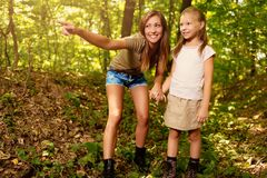 Young Woman And Little Girl In The Forest royalty free stock images