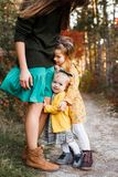Beautiful young mother and her little daughter walking in summer park. Woman and cute kid girl spending time together stock photos