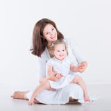 Beautiful young mother with her toddler daughter Royalty Free Stock Photo