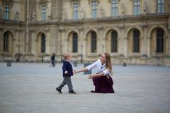 Beautiful young mother and her toddler son Stock Photo