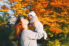 Happy beautiful young mother with her baby child on nature. Stock Image