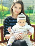 Beautiful young mother holding baby stock photos