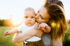 Young mother holding baby son in her arms Royalty Free Stock Image