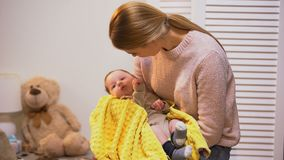 Beautiful young mother holding little baby son in arms, newborn love and care. Stock footage stock video footage