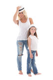 Beautiful young mother and little daughter posing with hats isol Stock Photos