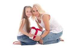 Beautiful young mother and little daughter sitting with gift box Royalty Free Stock Photo