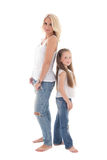 Beautiful young mother posing with little daughter isolated on w Stock Photos