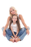 Beautiful young mother sitting with little daughter isolated on Royalty Free Stock Images