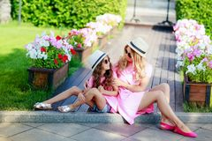 Beautiful young mother with small daughter walks through city royalty free stock photos