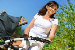 Beautiful young mother with stroller Stock Photo