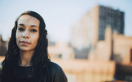 Beautiful young mulatto woman in urban environment Stock Images