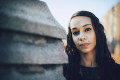 Beautiful young mulatto woman in urban environment Royalty Free Stock Photography