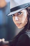 Beautiful young mulatto woman in urban environment Stock Image