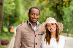 Beautiful young multi-ethnic couple having fun together at the park Royalty Free Stock Image