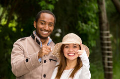 Beautiful young multi-ethnic couple having fun together at the park Stock Photo