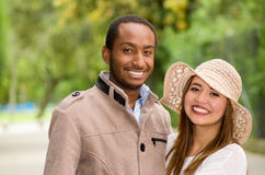 Beautiful young multi-ethnic couple having fun together at the park Royalty Free Stock Images