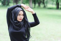 Beautiful young muslim asian woman doing exercise before running. royalty free stock images